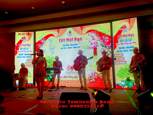 Ban Nhac Flamenco Tumbadora Tat Nien Nhan Loc Vivco Group New World Sg hotel